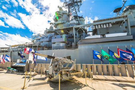 HONOLULU, OAHU, HAWAII, UNITED STATES - AUGUST 21, 2016: machine gun of the battleship Missouri at Pearl Harbor memorial site. National historic and patriotic landmark.