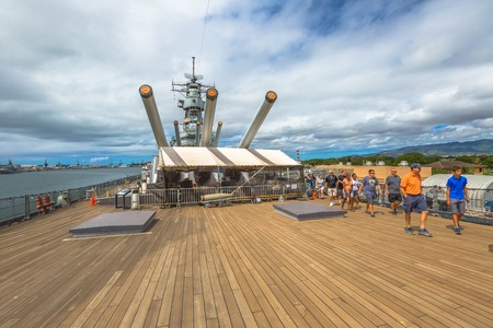 HONOLULU, OAHU, HAWAII, USA - AUGUST 21, 2016: The prow with big cannons of USS Missouri BB-63 warship at Pearl Harbor base. Commissioned in June 1944 for the World War II. Tourists in guided tour. Editorial