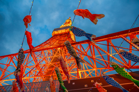 Tokyo, Japan - April 23, 2017: bottom view of Koinobori at Tokyo Tower by night. Koinobori are carp-shaped wind socks traditionally flown in Japan to celebrate Childrens Day during the Golden Week. Editorial