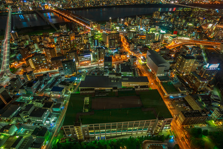 Aerial view of Osaka City Central business and Yodo River with its bridges at night. Osaka Skyline from Kita ward of Japan. Osaka is Japans third largest city by population after Tokyo and Yokohama.
