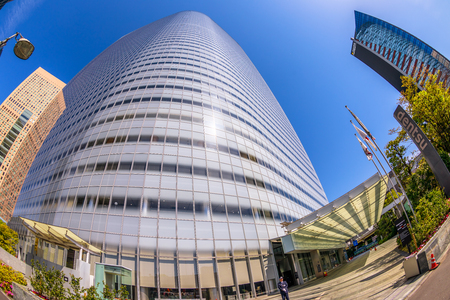 Tokyo, Japan - April 20, 2017: wide angle view of Dentsu Building the second tallest skyscraper in Shiodome of Minato, Tokyo, Japan, example of contemporary architecture. Fisheye shot.