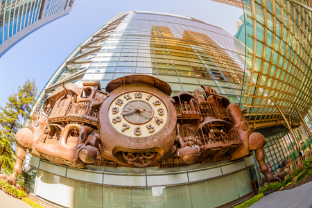 Tokyo, Japan - April 20, 2017: fisheye view of Ghibli clock in front of Nittele Tower (Nippon Television headquarters), Minato ward. The victorian steampunk clock icon of Shimbashi District. Editorial