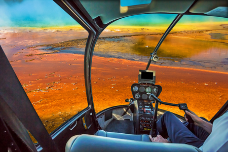 Helicopter cockpit with control console inside the cabin flight over Grand Prismatic Spring in the Midway Geyser Basin, largest thermal feature in Yellowstone NP, Wyoming and Montana, United States. Imagens
