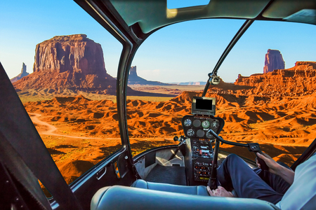 Helicopter cockpit with pilot arm and control console inside the cabin on scenic flight of Monument Valley Navajo Tribal Park, Arizona and Utah, America. Imagens