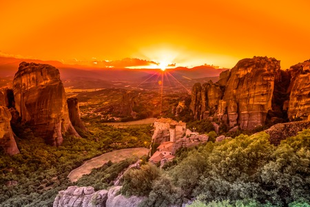 kalabaka: Spectacular colorful sunset over the valley of Meteora, from the best view point, a rock called Psaropetra, Kalambaka, Meteora, Central Greece. Stock Photo