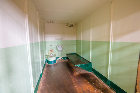 San Francisco, California, United States - August 14, 2016: Alcatraz isolation cells for inmates serving a prison sentence.All cells are single and small pitch black holes with 2 barred armoured doors