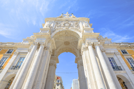 Prospective view of Rua Augusta Triumphal Arch in Commerce Square or Praca do Comercio. Rua Augusta Arch is a stone historic building and visitor attraction in Lisbon, Baixa District, Portugal.