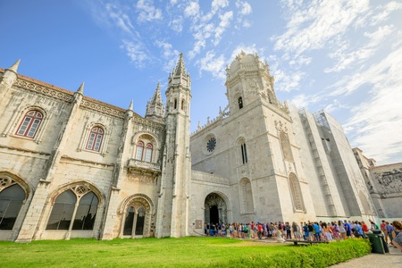 Crowd of people at entrance of Hieronymites Monastery or Mosteiro dos Jeronimos, Lisbon, Belem district on blurred background. The monastery is one of the citys main attractions and popular landmark