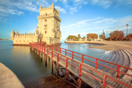 Belem Tower at low tide in the morning. Torre de Belem is Unesco Heritage and symbol of Lisbon, in Belem District on Tagus River. Belem Tower is the most visited tourist attraction in Lisbon, Portugal