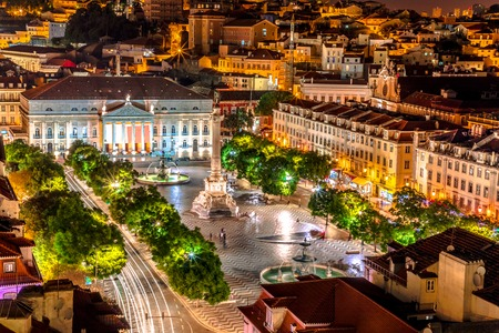 Scenic aerial view of Rossio Square or Pedro IV Square in Lisbon downtown, Portugal, from panoramic platform of Elevador de Santa Justa. Architecture background. Urban cityscape skyline. Night scene.