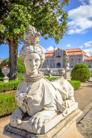 Close up of sphinx sculpture in Neptune gardens. Queluz National Palace, Sintra, Lisbon district, Portugal. The Royal Palace of Queluz was summer residence of Portuguese royal family.