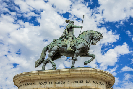 Equestrian statue of King John I in popular Praca da Figueira in the blue sky with clouds. Lisbon, Portugal, Europe. Stock Photo
