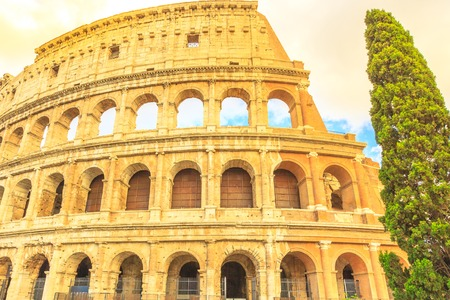 Side view of the Colosseo, Colosseum, Flavian Amphitheatre, the largest amphitheater in the world and one of the symbols of Italy. Symbol of Rome, located in historical center, Unesco Heritage Site.