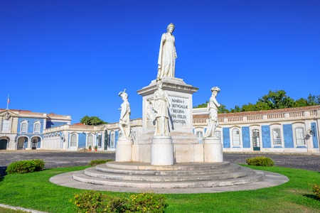 royals: Statue of Queen Maria I of Portugal at entrance of National Palace of Queluz in Sintra, Lisbon district, Portugal. The Royal Palace of Queluz was the summer residence of the Portuguese royal family.
