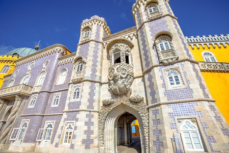 Bottom view of Pena National Palace entrance, in Portuguese Palacio da Pena or Castelo da Pena, Sintra, near Lisbon, in a sunny day. The palace is Unesco Heritage and one of Seven Wonders of Portugal. Stock Photo