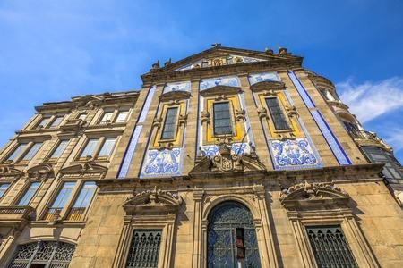 Azulejo tiles covering the facade of Saint Anthonys Church Congregados in Almeida Garrett square, Porto historic center, Portugal, Europe.