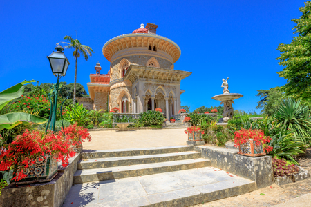 residential: Sintra, Portugal famous landmark. The arabesque Monserrate Palace or Palacio de Monserrate, the summer resort of Portuguese court. European travel. Sunny day in the blue sky.