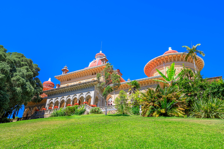 residential: Sintra, Portugal. The Monserrate Palace surrounded by botanical park in beautiful sunny day. Palacio de Monserrate is the summer resort of the Portuguese court.