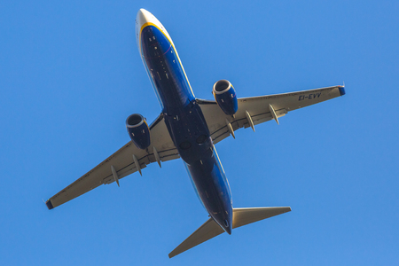 Bologna, Italy - December 20, 2016: a blue Ryanair passenger commercial jet plane isolated against the blue sky. Ryanair is main european low cost flights company