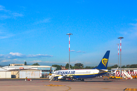 Bologna, Italy - June 30, 2017: Ryanair blue commercial airplane parked at Bologna airport BLQ, with blue sky and copy space. Ryanair is main european low cost flights company. Editorial