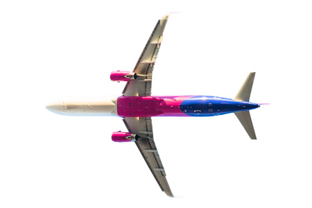 pink passenger commercial aircraft isolated on white background. low angle view