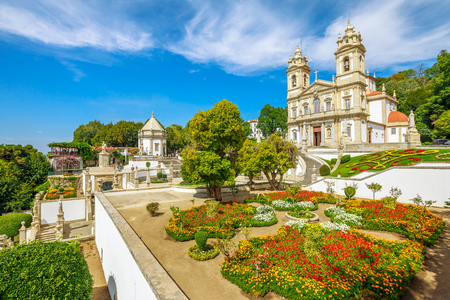 Historic Church of Bom Jesus do Monte and her public garden. Tenoes, Braga. The Basilica is a popular landmark and pilgrimage site in northern Portugal. Aerial landscape on the top of Braga mountain. 스톡 콘텐츠