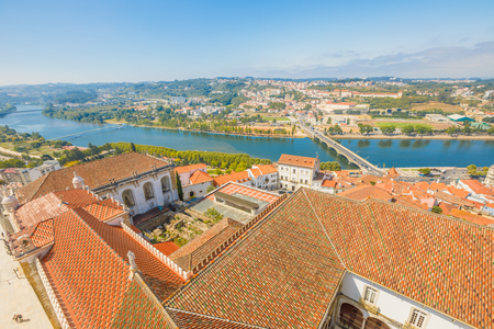 Coimbra cityscape and Santa Clara Bridge on Mondego river. Coimbra in Central Portugal, is famous for its University. Coimbra aerial view from bell clock tower in a sunny day.