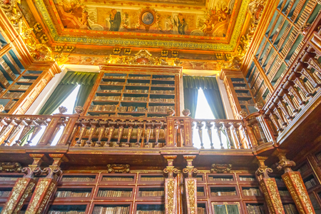 Coimbra, Portugal - August 14, 2017: University baroque library in Coimbra, the Europes oldest university founded in 1290. Unesco Heritage and most important tourist attraction in Coimbra.Bottom view Editorial