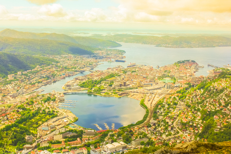 Scenic Bergen aerial view, Norway, Europe. Ulriken mountain is a popular landscape and landmark. Norwegian tourism highlight. Bergen overlook cityscape at sunset. Traveling to Northern Europe