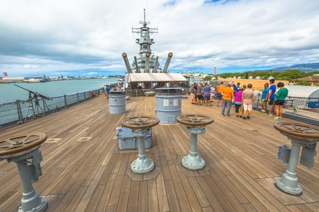 HONOLULU, OAHU, HAWAII, USA - AUGUST 21, 2016: prow with cannons of USS Missouri BB-63 warship at Pearl Harbor base. Commissioned in June 1944 for the World War II. With tourist taking pictures. Editorial