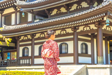Kamakura, Japan - April 23, 2017: woman wearing japanese kimono in front of Kannon-do or Main hall of Hase-dera Temple in Kamakura. Japanese culture and lifestyle. Spring season. Editorial