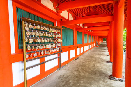 Nara, Japan - April 26, 2017: Wooden plaques or Ema, bearing peoples prayers at Kasuga-Taisha Shrine the Naras most celebrated shrine dedicated to the deity responsible for protection of city. Editorial