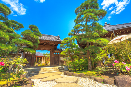Kamakura, Japan - April 23, 2017: entrance at traditional zen garden in a sunny day inside Hase-Dera Shinto. Hasedera Temple is a popular landmark in Kamakura. Concept of meditation and peace.