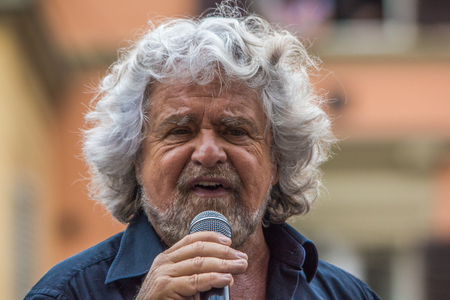 Bologna, Italy - May 10, 2014:  Beppe Grillo speaks in Piazza San Francesco for Movimento 5 Stelle M5S party, close up portrait of its leader speaking