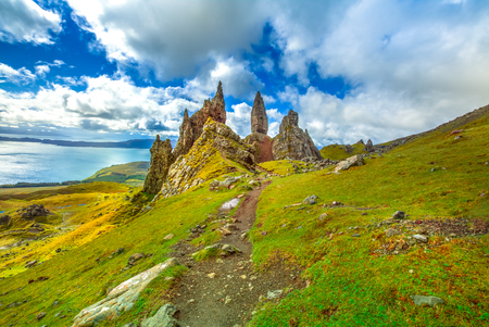 Old Man of Storr, large pinnacle of rock on top of a north hill in the isle of Skye, Highlands in Scotland, United Kingdom.