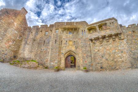 doorway of the Eilean Donan Castle from the internal yard on side entrance in Dornie town, Scotland, United Kingdom