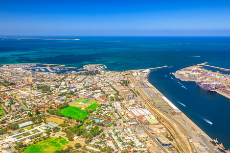 Aerial view of Fremantle Harbour, the Western Australia's largest and busiest general cargo port. Scenic flight over Fishing Boat Harbour, North Mole Lighthouse and Swan River, Australia. Copy space.