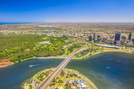 Aerial view of Perth City in Australia. Scenic flight over Narrows Bridge, Swan River, Kings Park, Mill Point, Perth Convention and Exhibition Center in Western Australia. Copy space.