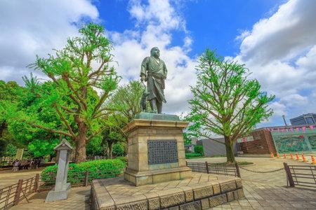 Tokyo, Japan - April 18, 2017: Statue of Saigo Takamori The Last Samurai atop the stone steps in Sannodai Square near main entrance to Ueno Park, next Ueno Station in central Tokyo in spring season.
