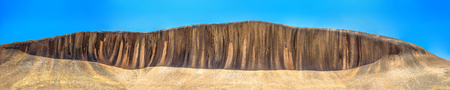 Panorama wide view of Wave Rock an ocean wave shaped rock , located in Hyden Wildlife Park, Western Australia. 15 m - 49 ft high and around 110 m - 360 ft long. Famous landmark in Australian outback.