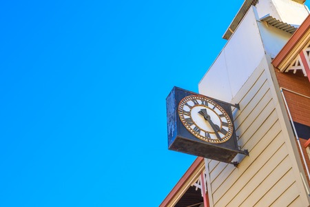 Close-up of old clock on a historic building constructed in 1908 on Avon Terrace in York, in the east tourist town of Perth in Avon Valley, Western Australia. Blue sky with copy space.