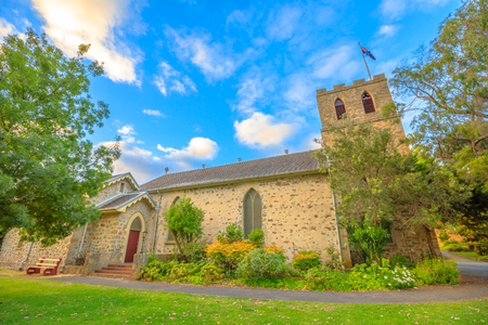 Famous landmark of St John the Evangelist Anglican Church, the oldest church to be consecrated in Western Australia. This side view is from Peel Place in Albany. Sunset light shot.