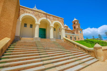Bottom view of stairway from up Cathedral Ave of St. Francis Xaviers Cathedral in Geraldton, Western Australia. The Cathedral is the most important Catholic church in Geraldton. Sunny day.