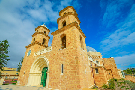Bottom view of romanesque St. Francis Xaviers Cathedral with Twin Towers and Dome in Geraldton, Western Australia. The Cathedral is the most important Catholic church in Geraldton.