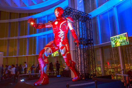 Tokyo, Japan - April 20, 2017: a gigantic statue of Iron Man of Marvel Age of Heroes Exhibition, at 52nd floor of Mori Tower in Roppongi Hills complex, from where you can admire Tokyo skyline.