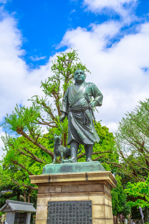 Tokyo, Japan - April 18, 2017: Statue of Saigo Takamori The Last Samurai atop the stone steps in Sannodai Square near main entrance to Ueno Park, next Ueno Station in central Tokyo. Vertical shot.