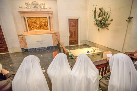 Fatima, Portugal - August 15, 2017: nuns pray before one of graves of shepherds who saw the apparitions of Virgin Mary, inside Basilica of Our Lady of Fatima, the biggest pilgrimage Site in Portugal Editorial
