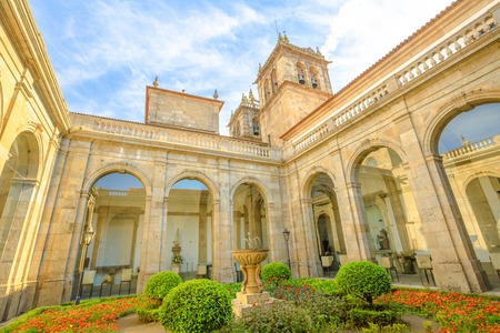 Braga, Portugal - August 12, 2017: Cathedral Treasure or Sacred Art Museum, incorporated in Braga Cathedral, the most important monument in Braga city. Perspective view of garden and the bell towers.