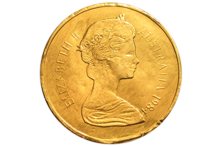 Australian golden chocolate coin of 1 dollar of Australia, AUD currency, close up of the head side of Queen Elizabeth II. Isolated on white studio background. Stock Photo