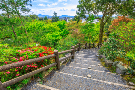 Arashiyama city panorama and aerial view of Tenryu-ji Zen Temple on the hill above the temple in the mountains on western outskirts of Kyoto, Japan. Garden path of a hundred flowers or Hyakkaen.